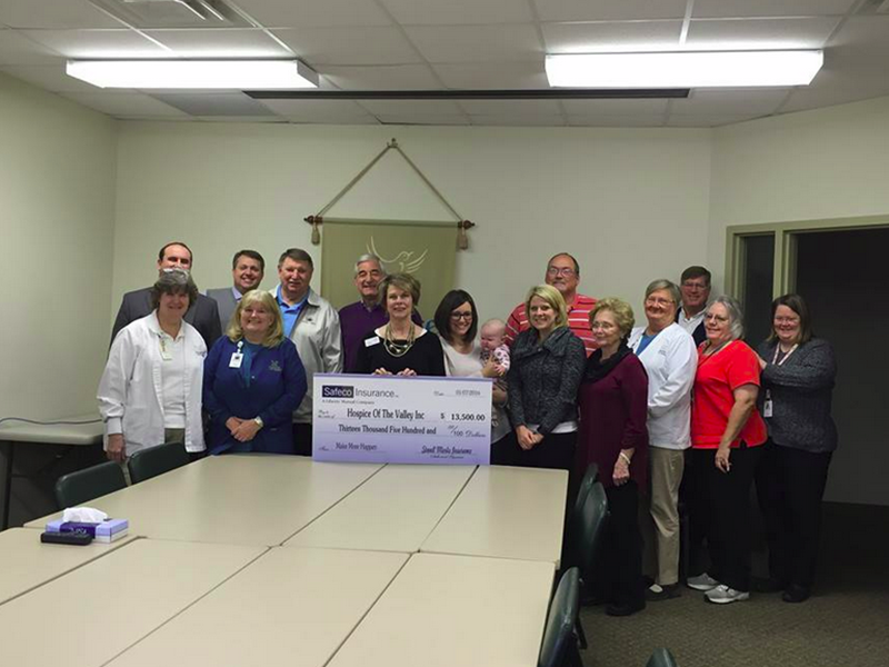 Stovall Marks Insurance Team donating check to Hospice of the Valley Inc.